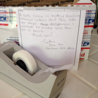 Picture of tape dispenser and note from Gresham post office.