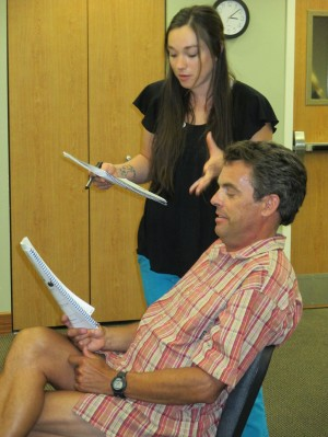 Image of seated man and standing woman doing role play exercise