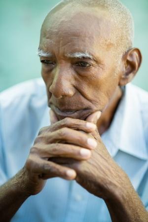 Contemplative senior man looking into distance