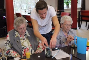 Student Onno Selbach interacts with two nursing home residents at Humanitas in the Netherlands. Selbach helped create an intergenerational program there that offers students rent-free housing. Photo courtesy of Humanitas